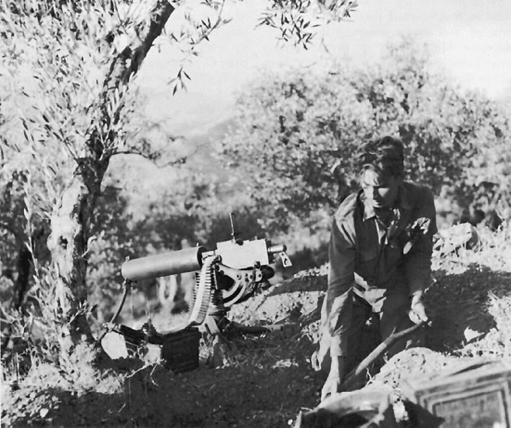 Digging in a machine gun position on Monte Cipolla, 11 August 1943